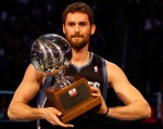 Ex-Bruin Kevin Love, now of the Minnesota Timberwolves, hoists the 3-point shooting title trophy at All-Star Weekend in Orlando. courtesy: Getty Images