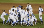 Bruins rush the mound celebrating UCLA's first baseball title, the school's 109th national championship. courtesy:   NATI HARNIK — AP Photo