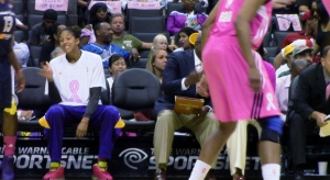 Sparks star Candace Parker, sidelined with a strained left knee,  grimaces during L.A.'s 77-73 win over Indiana Monday night at Staples Center.