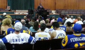 Members of Bring Back the L.A. Rams listen to Inglewood Mayor James T. Butts discussing bringing the NFL to Hollywood Park. St. Louis Rams owner Stan Kroenke owns 60 acres of Inglewood land.