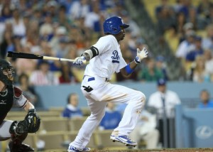 Dodgers' Dee Gordon hits the game-winning RBI single in the 8th. Los Angeles beat Arizona, 5-2 maintaining its two-game lead over San Francisco in the N.L. West. courtesy: Stephen Dunn/Getty Images