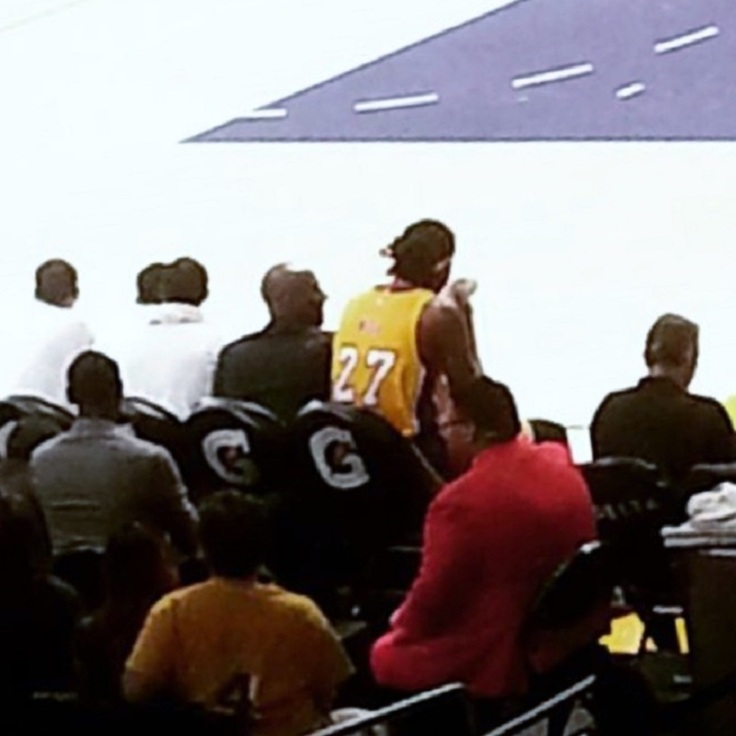 Kobe Bryant can do nothing but watch from the bench in street clothes as the Lakers fall to the Jazz, 80-73.